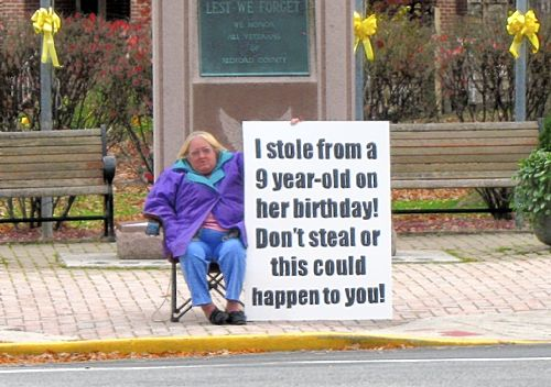 17 People Forced To Hold Signs As Punishment